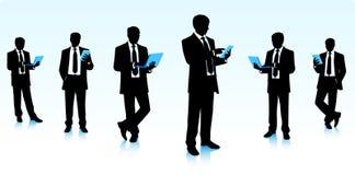 Geschäftsmänner mit Computern Stockbild