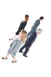 Geschäftsmänner und Geschäftsfraugehen lizenzfreies stockfoto