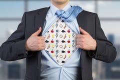 Geschäftsmann öffnen sein Hemd Stockfotografie