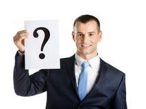 Geschäftsmann übergibt Papier mit Fragezeichen Stockbild