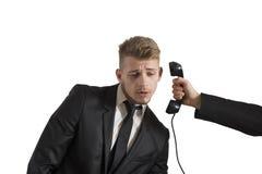 Geschäftsmann überrascht durch einen Anruf Stockbilder
