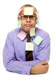 Geschäftsmann abgedeckt mit klebrigen Anmerkungen Stockfotos
