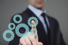 Geschäftsmann Activate Gears, Touch Screen Konzept lizenzfreie abbildung