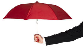 Geschäftsmann-Arm Holding Red-Regenschirm lokalisiert Stockfotos