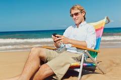 Geschäftsmann auf dem Strand Stockfotografie