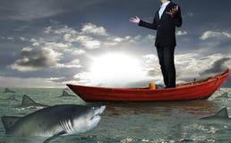 Geschäftsmann auf einem Boot stockfoto