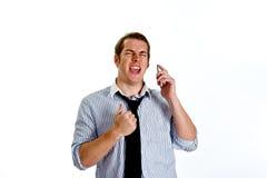 Geschäftsmann auf einem Handy Lizenzfreie Stockbilder
