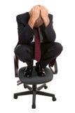 Geschäftsmann auf einem Stuhl. lizenzfreie stockfotos