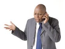 Geschäftsmann auf Handy Lizenzfreie Stockbilder