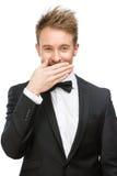Geschäftsmann bedeckt Mund mit der Hand stockfoto