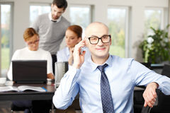 Geschäftsmann bei der Sitzung Stockfotos