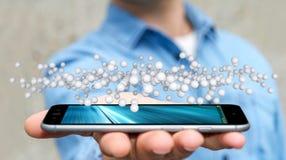 Geschäftsmann, der abstrakte Verbindungsschnittstelle über Telefon 3D hält Lizenzfreies Stockfoto