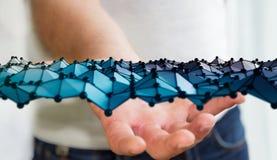 Geschäftsmann, der abstrakte Wellenverbindung mit Punkten und Linien hält Stockfotografie