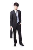 Geschäftsmann, der Aktenkoffer steht und anhält Stockfotografie