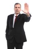 Geschäftsmann, der ANSCHLAG mit seiner Hand gestikuliert Lizenzfreies Stockbild