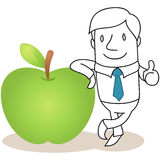 Geschäftsmann, der am Apfel sich lehnt Stockfoto