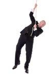 Geschäftsmann, der am Seil hängt stockfotos