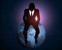 Geschäftsmann, der auf einer Erde sitzt Stockbilder