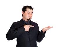 Geschäftsmann, der auf Produkt zeigt Stockbilder