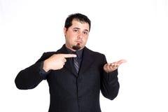Geschäftsmann, der auf Produkt zeigt Stockfoto
