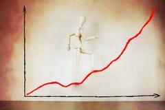 Geschäftsmann, der auf steigendes Diagramm steigt Lizenzfreie Stockfotografie