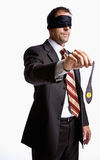 Geschäftsmann in der Augenbinde mit Eselheck Lizenzfreies Stockbild
