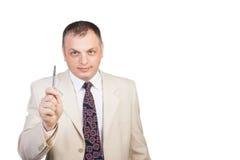 Geschäftsmann, der Bereich für Zeichen zeigt Stockbilder