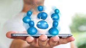 Geschäftsmann, der blaue Wiedergabe des Ikonensozialen netzes 3D hält Stockfotos
