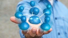 Geschäftsmann, der blaue Wiedergabe des Ikonensozialen netzes 3D hält Stockbilder