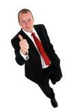 Geschäftsmann, der das Thumbs-upzeichen. gibt lizenzfreie stockfotos