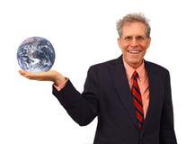 Geschäftsmann, der den Planeten anhält Stockbild