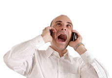 Geschäftsmann, der an den Telefonen schreit Lizenzfreies Stockbild