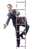 Geschäftsmann, der die Leiter steigt Stockfoto