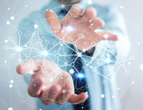 Geschäftsmann, der digitales Datennetz in seinem Hand-3D renderin hält Lizenzfreie Stockbilder