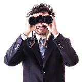 Geschäftsmann, der durch Binokel schaut Lizenzfreie Stockfotografie