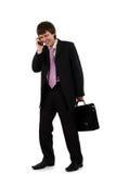 Geschäftsmann, der durch Telefon spricht Stockbild
