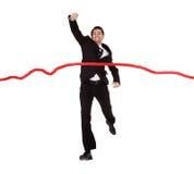 Geschäftsmann, der durch Ziellinie läuft Stockfotos