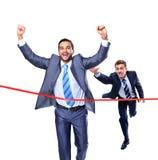 Geschäftsmann, der durch Ziellinie läuft Lizenzfreies Stockfoto