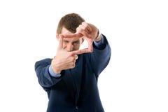Geschäftsmann, der ein Feld mit seinen Händen bildet Stockfotos
