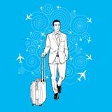 Geschäftsmann, der ein Gepäck am Flughafen trägt Lizenzfreies Stockfoto