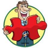 Geschäftsmann, der ein großes rotes Puzzlespielstück anhält Stockfotografie