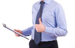 Geschäftsmann, der ein Klemmbrett hält. Stockbild