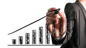 Geschäftsmann, der ein steigendes Balkendiagramm zeichnet Lizenzfreie Stockfotos