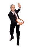 Geschäftsmann, der eine Borduhr anhält Stockfotos