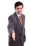 Geschäftsmann, der eine Handerschütterung gibt Stockfotografie
