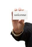Geschäftsmann, der eine willkommene Visitenkarte übergibt Lizenzfreies Stockfoto