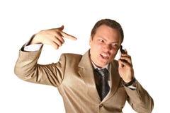 Geschäftsmann, der an einem Telefon schreit Stockfotografie
