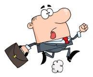 Geschäftsmann, der einen Aktenkoffer tragend, um zu arbeiten läuft Stockfoto
