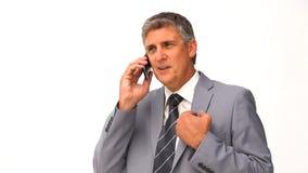 Geschäftsmann, der einen Aufruf bildet stock footage