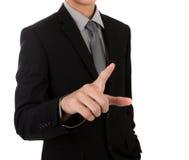 Geschäftsmann, der einen eingebildeten Bildschirm berührt Stockbild